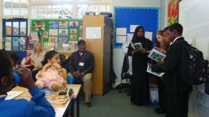 My young writers reading their poetry to primary school pupils